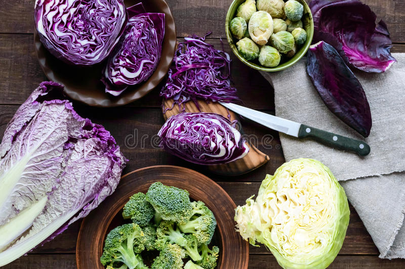 Many kinds of cabbage - red, broccoli, Brussels sprouts, white, napa cabbage. Ingredients for the preparation of vegetable dishes. The top view stock photo