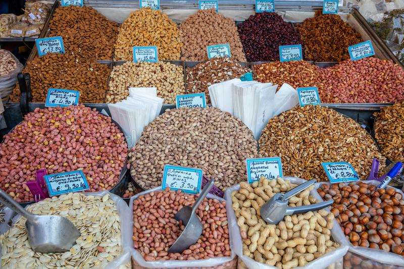 Many kinds of nuts at street market stall in Athens, Greece. Proper healthy seeds background for vegan and vegetarian stock image