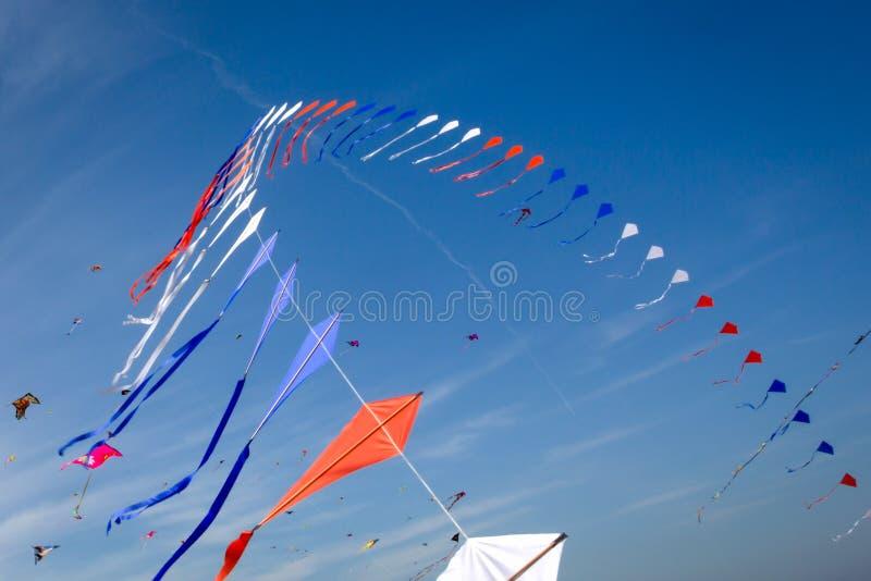 Many kites flying. In the blue sky royalty free stock photos