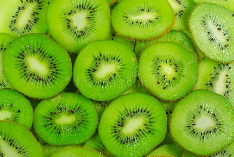 Many kiwi fruit slices background.  stock image