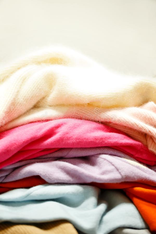 Many knitted wool sweaters. stock photos