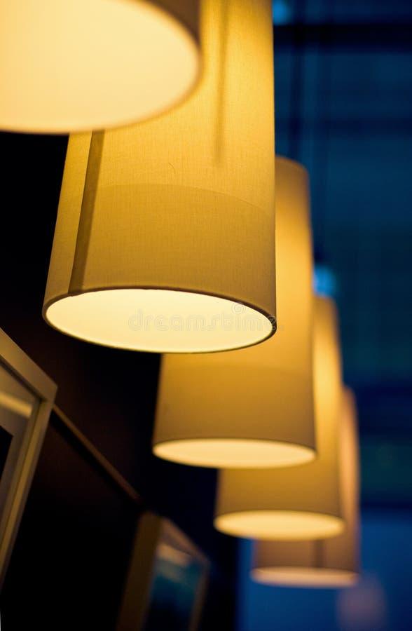 Many lamps at dark restaurant royalty free stock photo