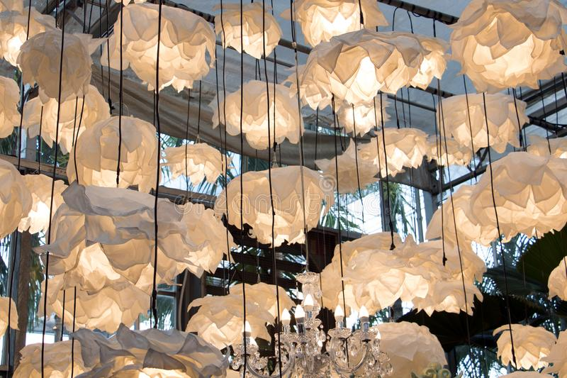 Many lamps hang from the ceiling in the greenhouse. royalty free stock photos