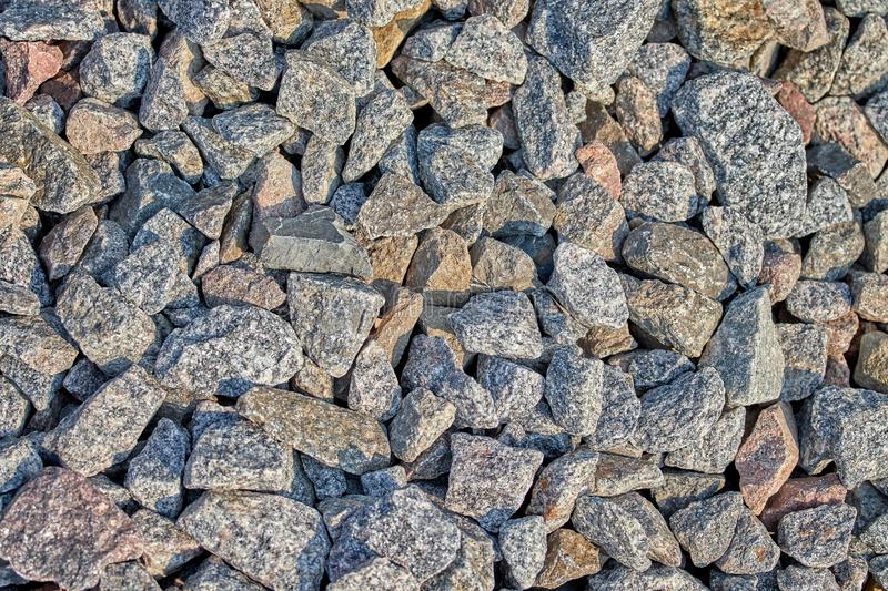 Many large stones for cargo on the railroad. Many large stones for cargo on the railway to drain water and low electrical conductivity rubble ballast background stock photos