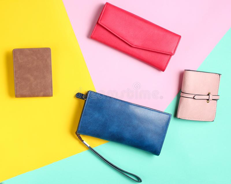 Many leather purses on a colored pastel background. Top View. royalty free stock photography