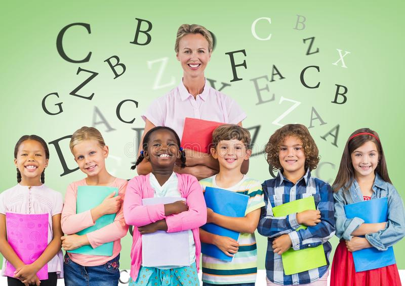Many letters around Kids holding schoolbooks with teacher in front of green background stock photo