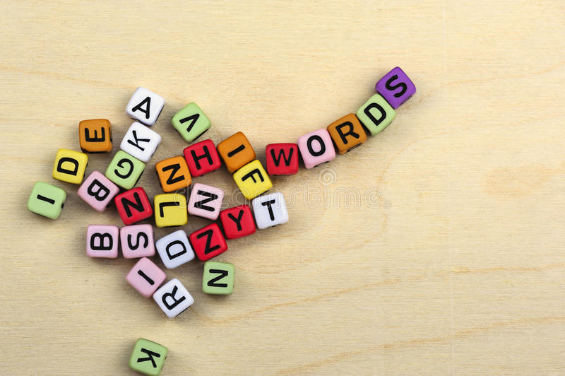 Many letters on colorful blocks form words stock photos