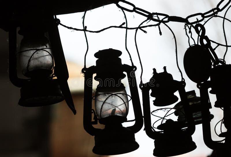 Many lit storm lanterns or hurricane lamps. Background of many lit storm lanterns or hurricane lamps royalty free stock photo