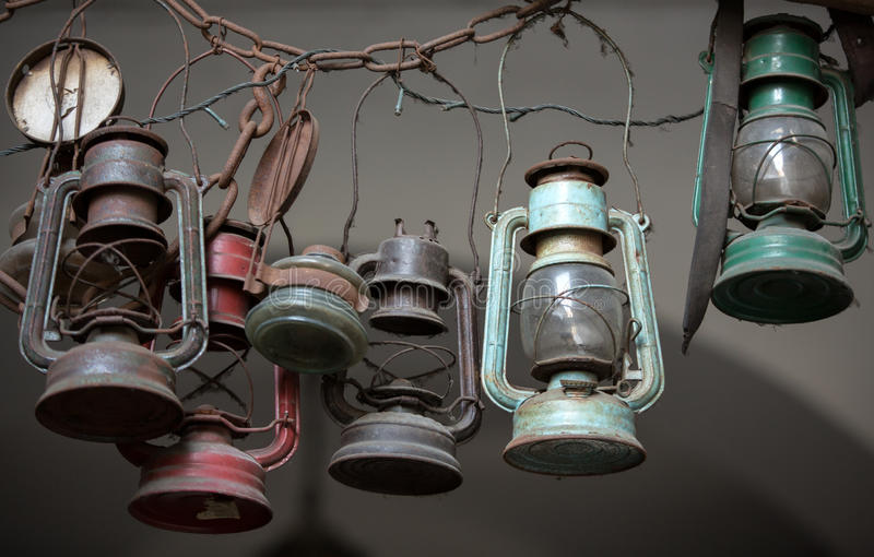 Many lit storm lanterns or hurricane lamps. Background of many lit storm lanterns or hurricane lamps stock photography