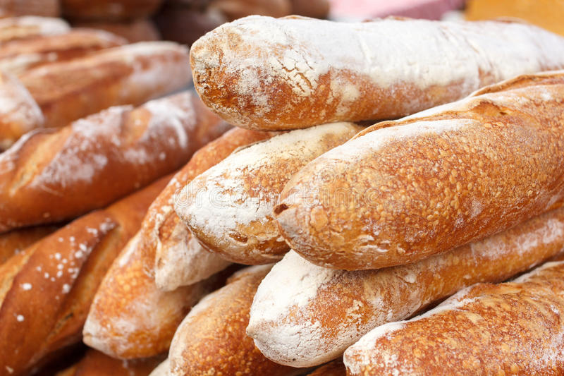 Many loaves of bread stacked in a market environment royalty free stock photo