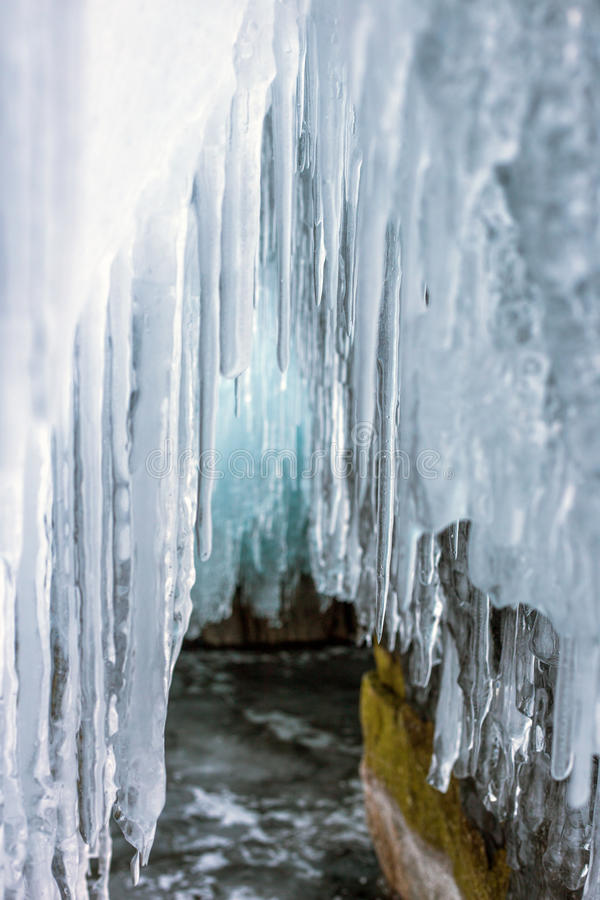 Many long transparent icicles in the ice cave, Lake Baikal royalty free stock image