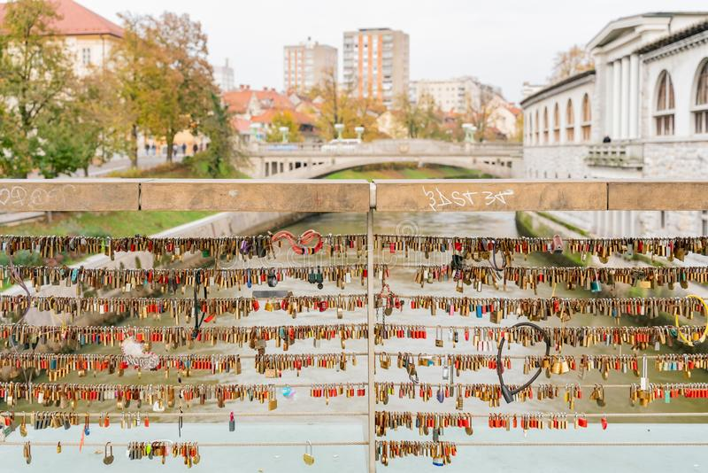 Many love padlocks locked on the famous Mesarski Most (Butchers ' Bridge. ) at Ljubljana, Slovenia royalty free stock photo