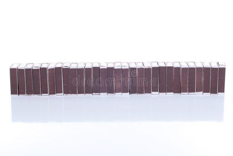 Many Matchbox isolated on white background with reflection. Many Matchbox isolated white background with reflection royalty free stock images