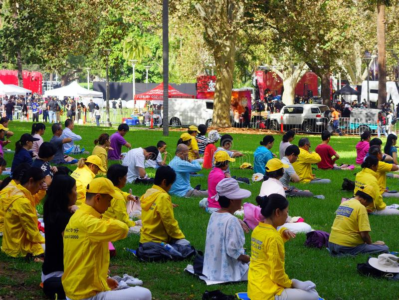 Falun Gong Members Meditating in Hyde Park, Sydney, Australia. Many members of Falun Gong, a modern Chinese spiritual practice that combines meditation and royalty free stock photo