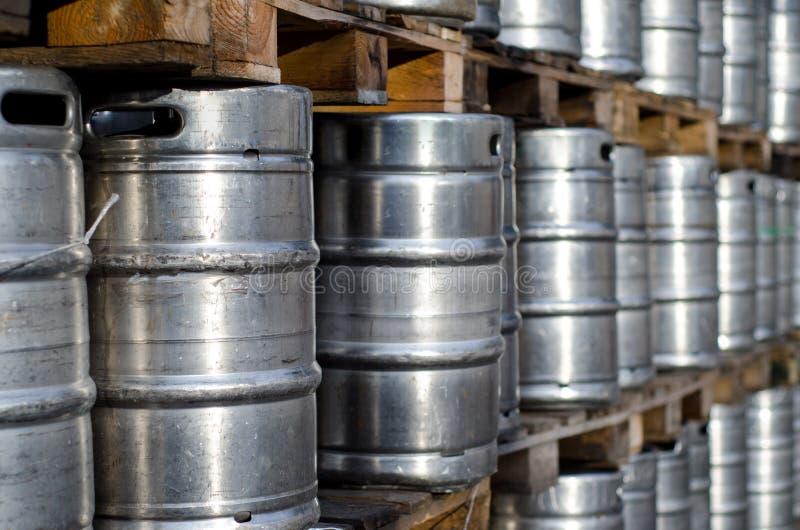 Many metal beer kegs. Close-up of many metal beer kegs royalty free stock photo