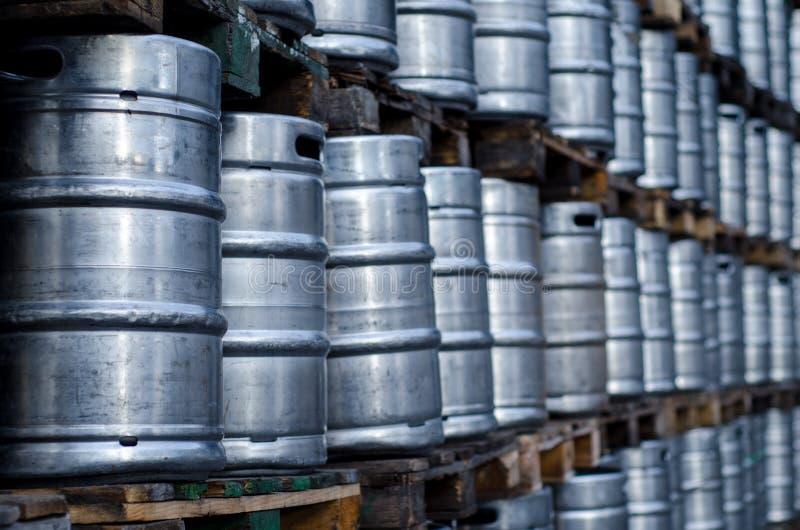 Many metal beer kegs. Close-up of many metal beer kegs royalty free stock photos