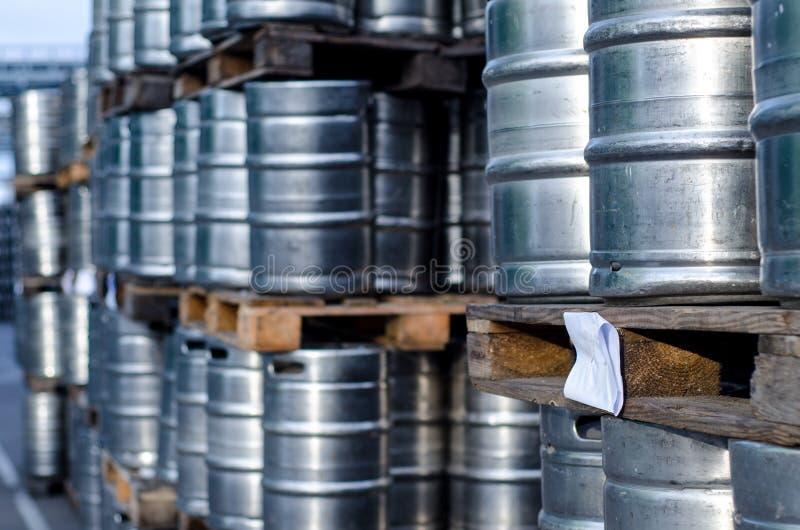 Many metal beer kegs. Close-up of many metal beer kegs stock images