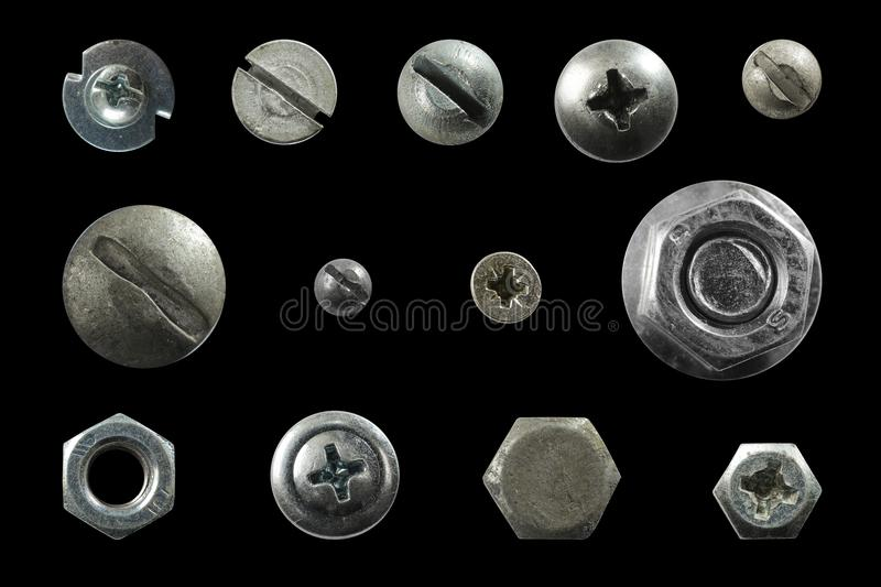 Many metal heads of screws, nuts, rivets stock photos
