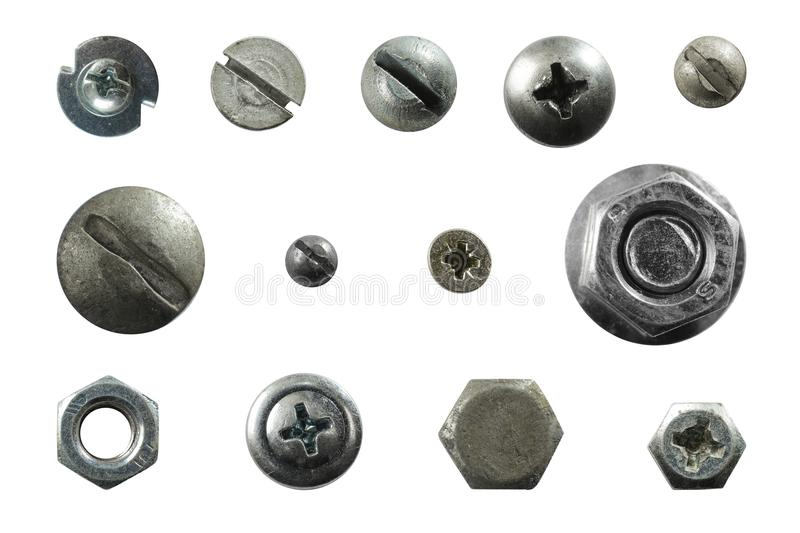 Many metal heads of screws, nuts, rivets stock photo