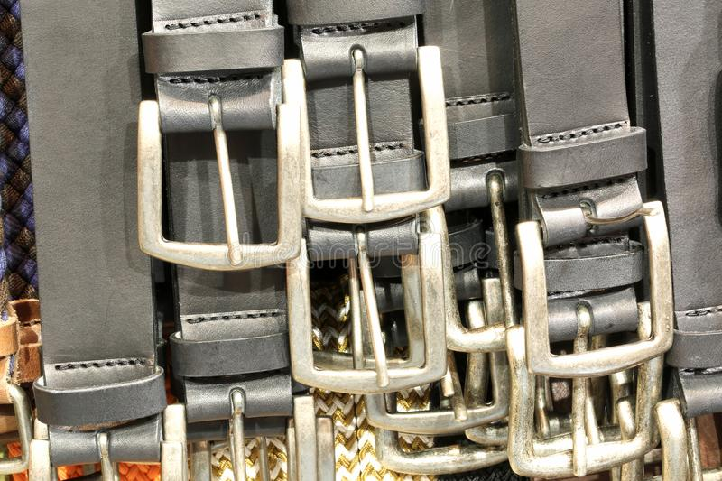 Buckles of leather belts for sale in the leather goods shop. Many metallic buckles of leather belts for sale in the leather goods shop royalty free stock photos