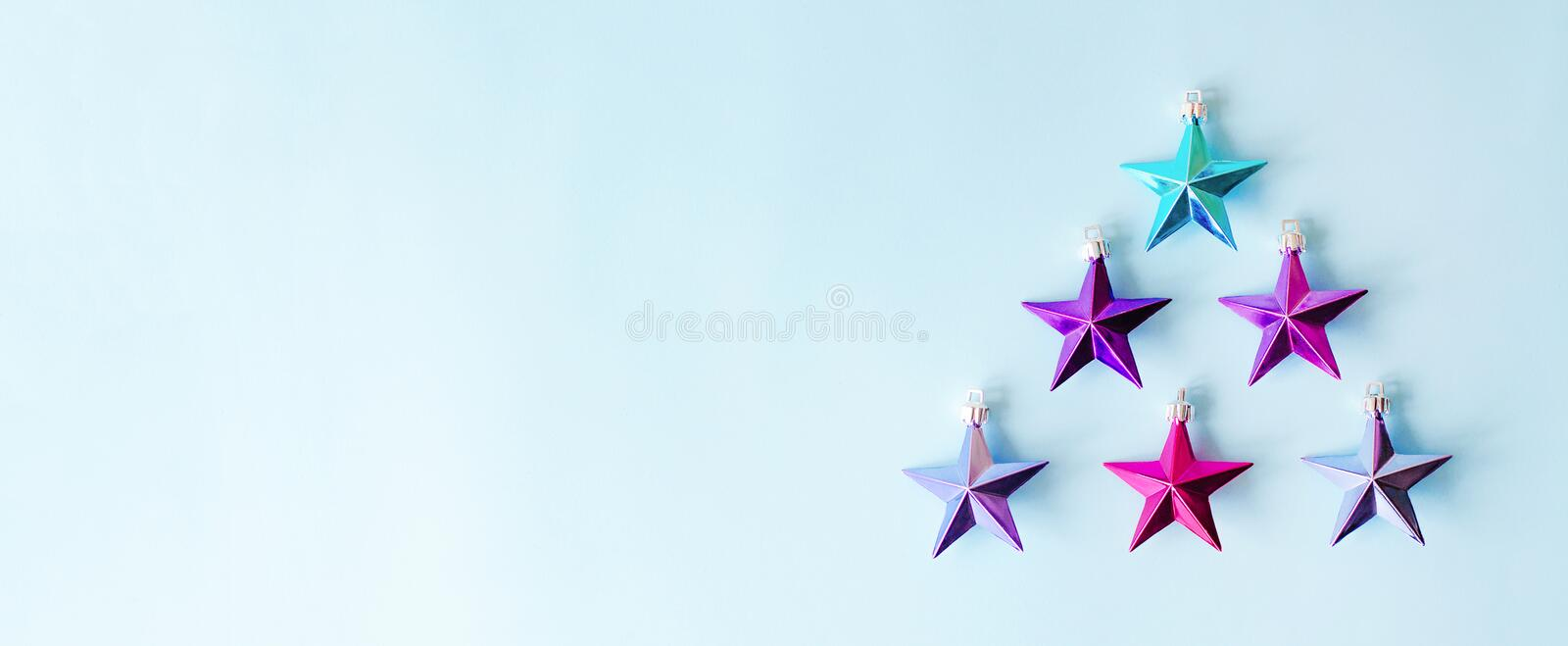 Many metallic stars in the shape of a Christmas tree. royalty free stock image