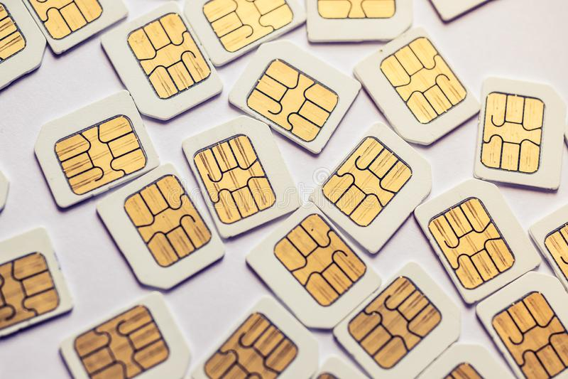 Many Micro SIM 3G for mobile over on white background royalty free stock images