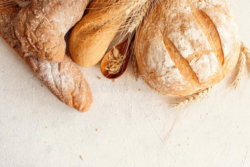 Many mixed breads and rolls shot from above royalty free stock photography