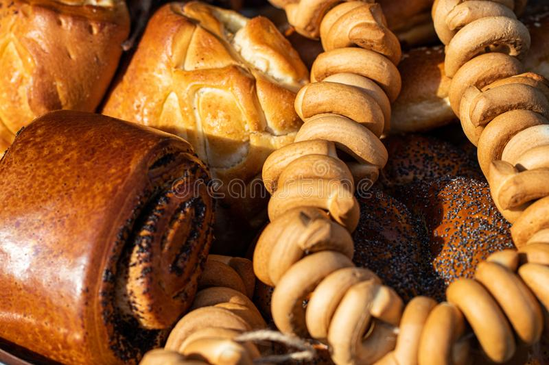 Many mixed breads and rolls shot from above stock images