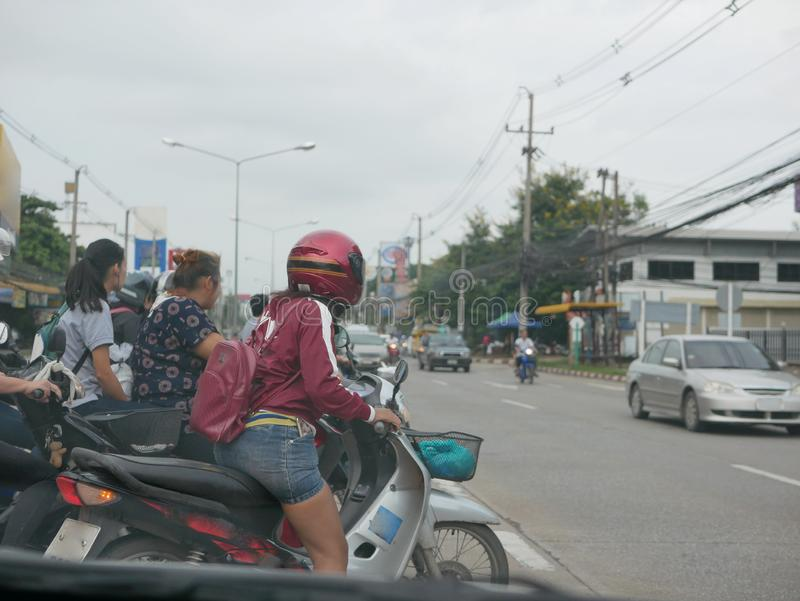 Many motorbike riders waiting and about to take off at a U-turn royalty free stock photo