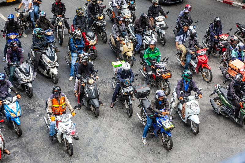 Many motorbikes motorcycles stopped at traffic lights waiting for the green light. Bangkok, Pathumwan / Thailand - July 22, 2019: Many motorbikes motorcycles royalty free stock images