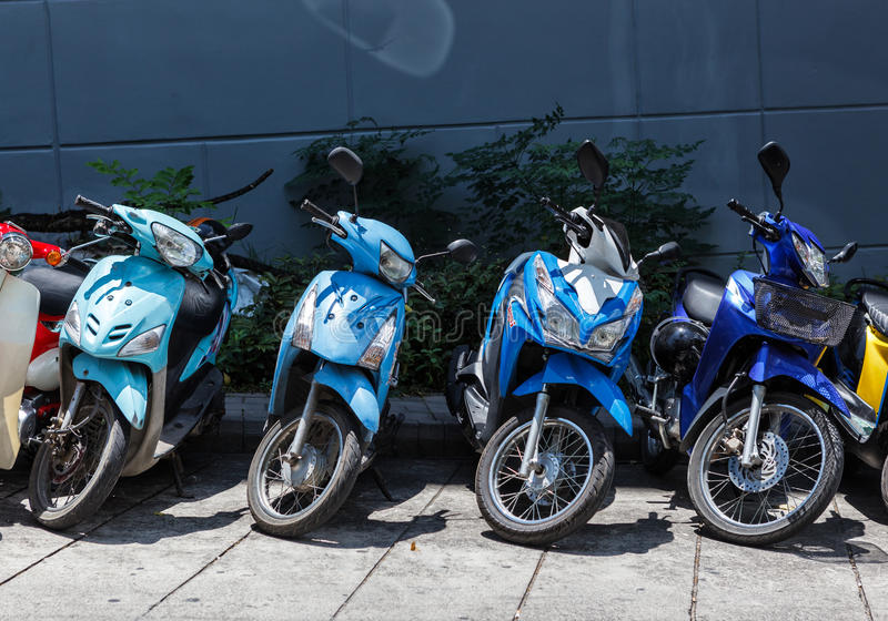 Many motorbikes at the parking. Near big store royalty free stock photo