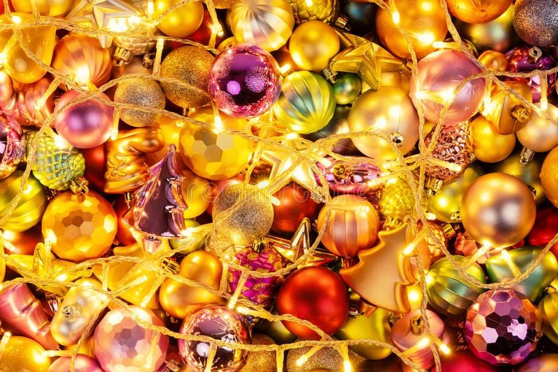 Many multi-colored christmas toys and lights garland background texture. Top view. royalty free stock photo
