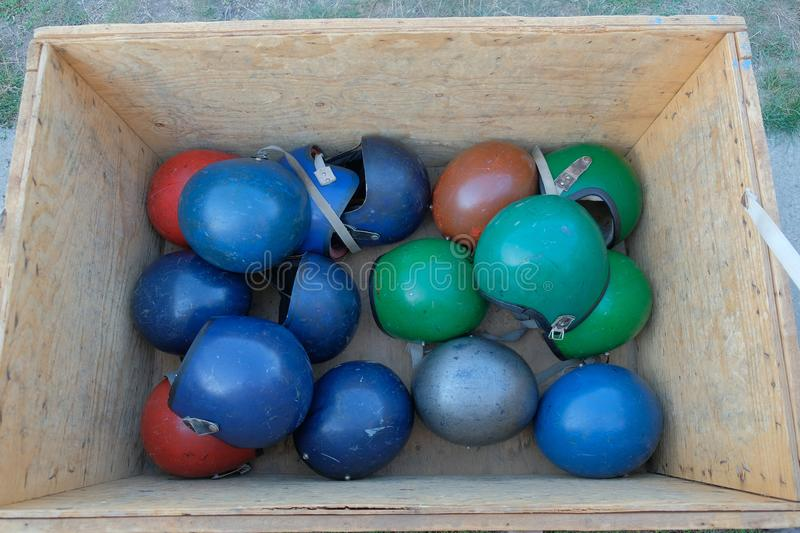 Many multi-colored helmets for parachuting. In a storage box royalty free stock images