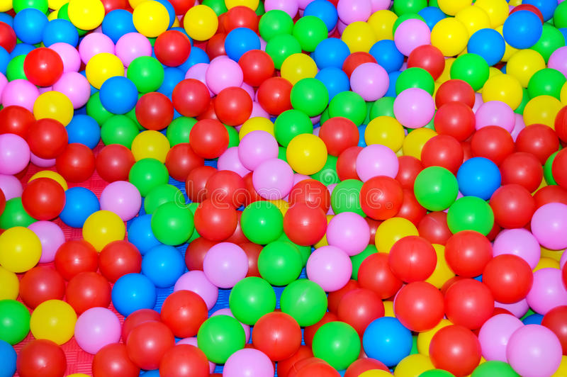 Many multi-colored plastic balls. For children`s rooms, playgrounds. royalty free stock photography