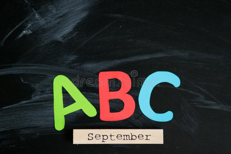 Many multicolored letters on blackboard. Knowledge concept stock photos