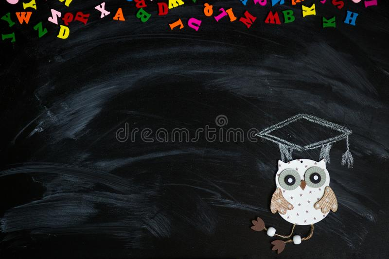 Many multicolored letters isolated on blackboard. Knowledge concept royalty free stock image