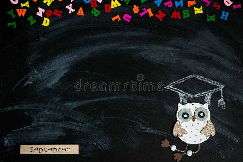 Many multicolored letters isolated on blackboard. Knowledge concept stock image