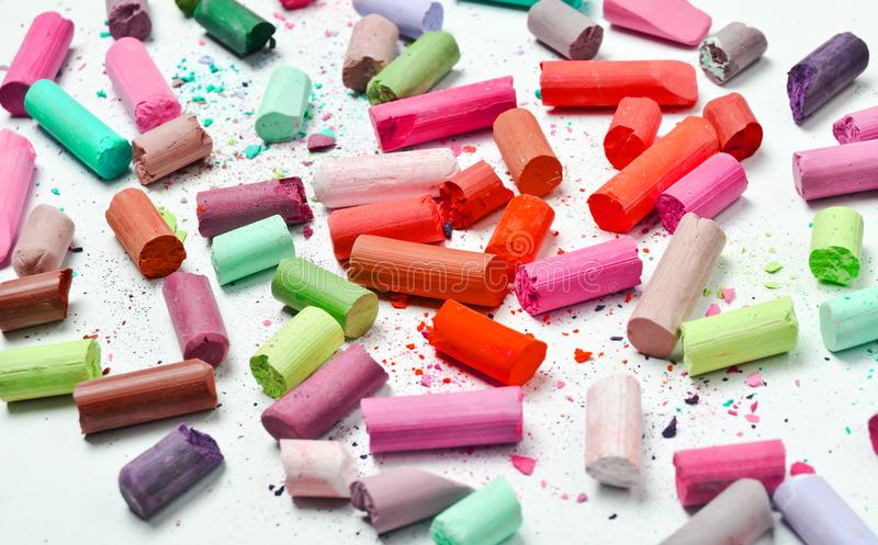 Many multicolored pastel crayons on a white background. royalty free stock images