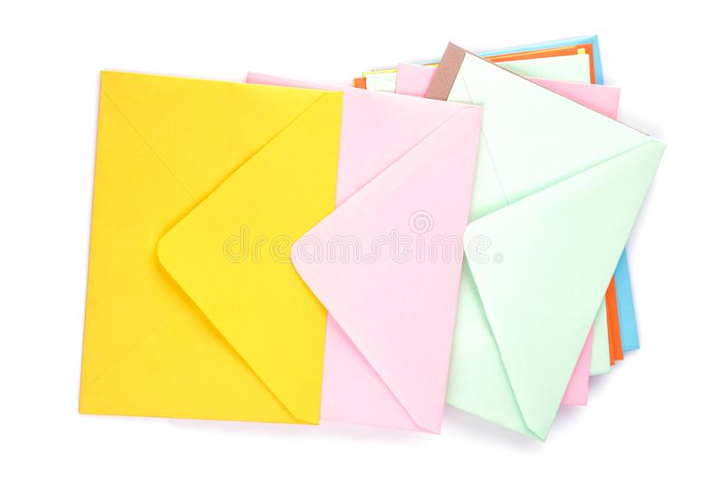 Many multicolored postal envelopes on a white isolated background. mail concept. royalty free stock images