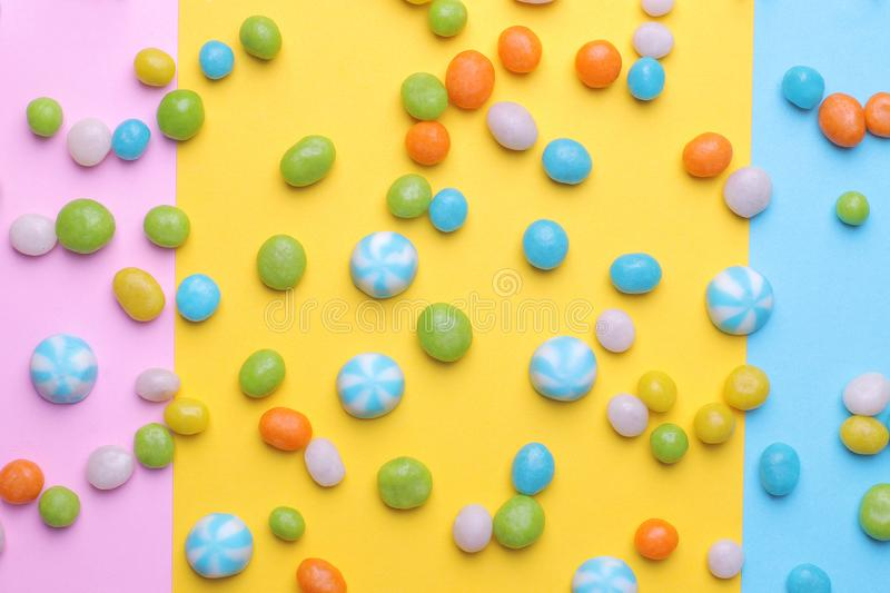 Multicolored round candy on colorful bright backgrounds. Top view stock photos