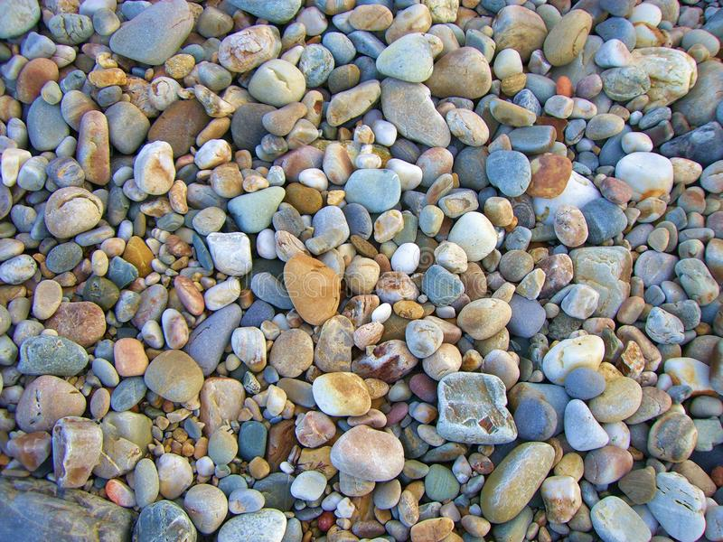 Lot`s of stones here. Many multicolored stones ont he ground royalty free stock image