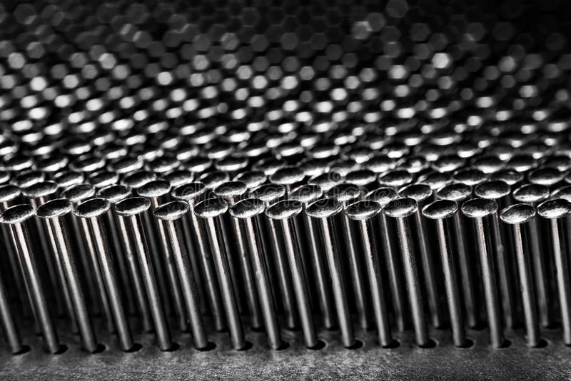 Many nails on a dark background stock photography
