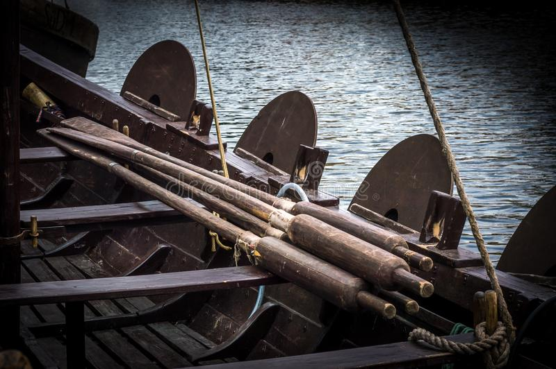 Oars in a viking boat. Many oars resting on the seats in a viking sail boat stock photos