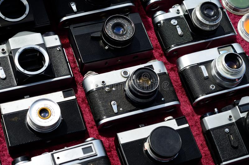 Many old cameras. For sale stock photography
