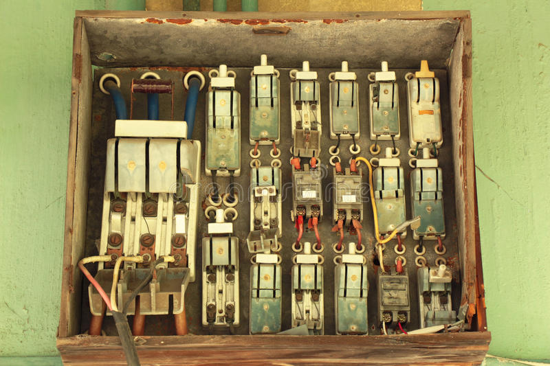 Many old electric switches on wood plate. This photo is took on National Taiwan University. Many electronic switches on a wood plate. They are all old and have a stock photos
