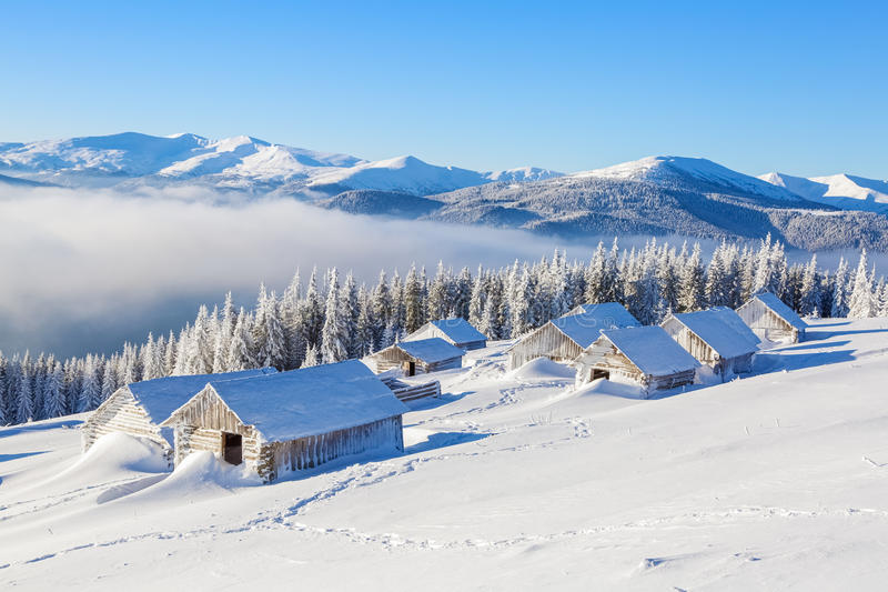Many old houses stand covered with snow. royalty free stock photography