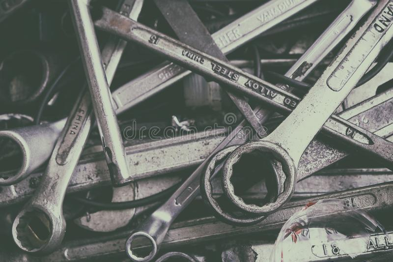 Many Old and Used Box Wrench in the Tools Box in the Garage stock images
