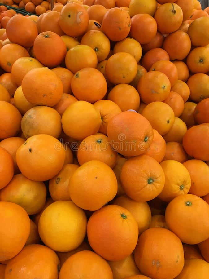 Many oranges for sale royalty free stock photography