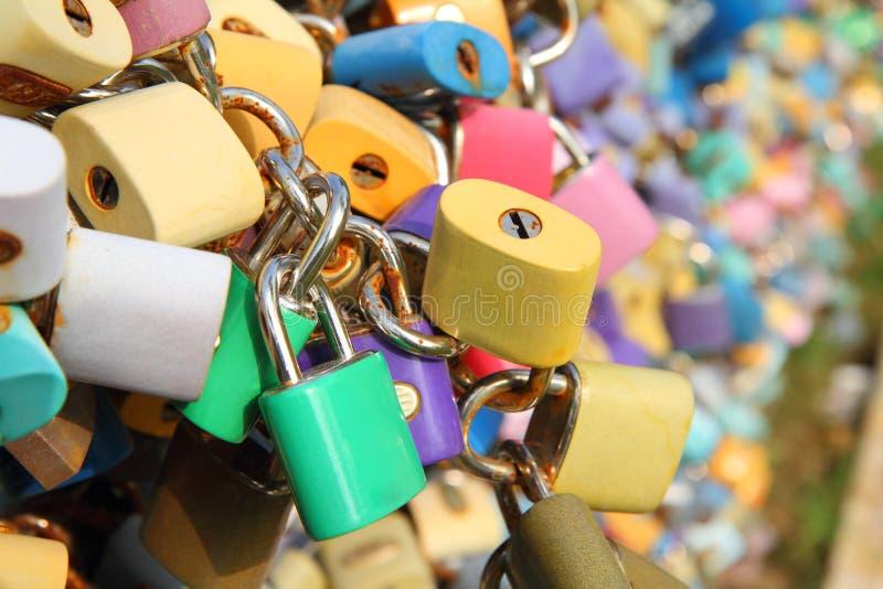 Many padlocks on the bridge. A symbol of eternal love stock image