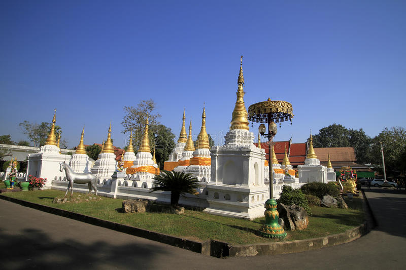 Many pagodas with beep blue sky at Wat-Chedi-Sao-Lang, Lampang royalty free stock image